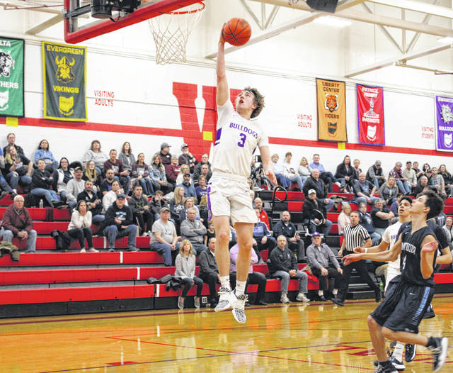 Swanton's Josh Vance turns a steal into points at the other end late in the third quarter of Tuesday's sectional semifinal versus Montpelier. Vance led all scorers with 19 points, lifting the Bulldogs to a 48-41 win.
