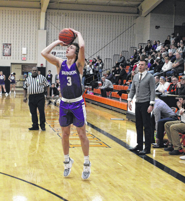 Swanton's Josh Vance attempts a 3-pointer Friday night in NWOAL play at Liberty Center. Vance scored 14 points to lead all Bulldog scorers.