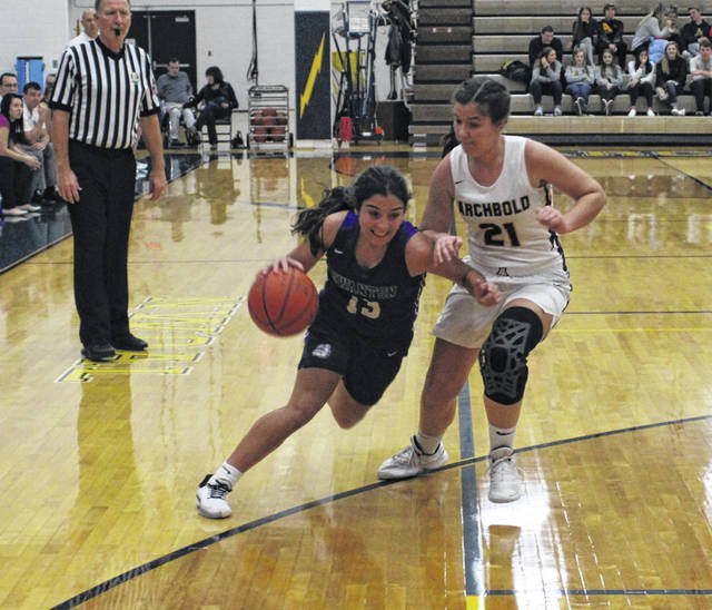 Swanton's Aricka Lutz drives around an Archbold defender in the two team's NWOAL matchup this season. Lutz was named second team all-district in Division III.
