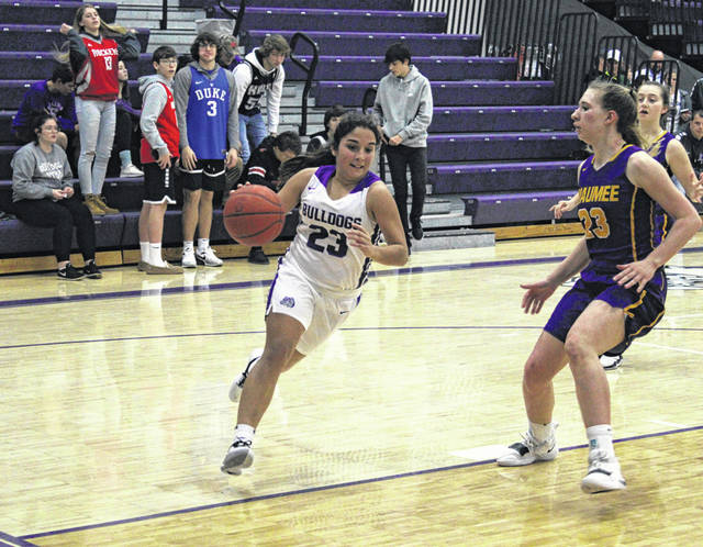 Averie Lutz of Swanton drives to the hoop in a game against Maumee this season. She was named second team All-District 7.