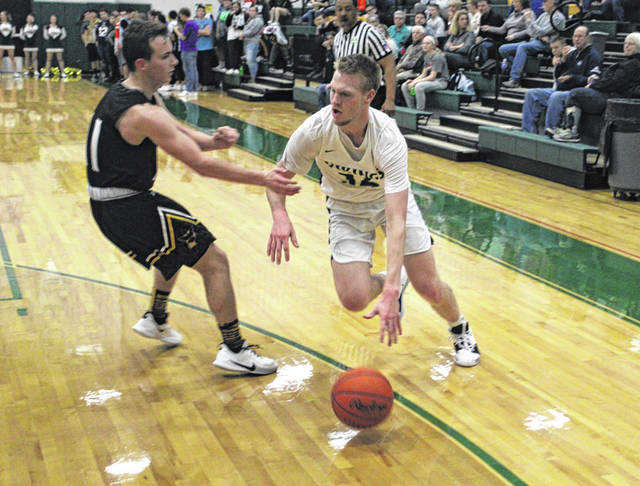 Evergreen's Nate Brighton dribbles past a Pettisville defender in a game this season. It is possible he has played his final game in a Viking uniform.