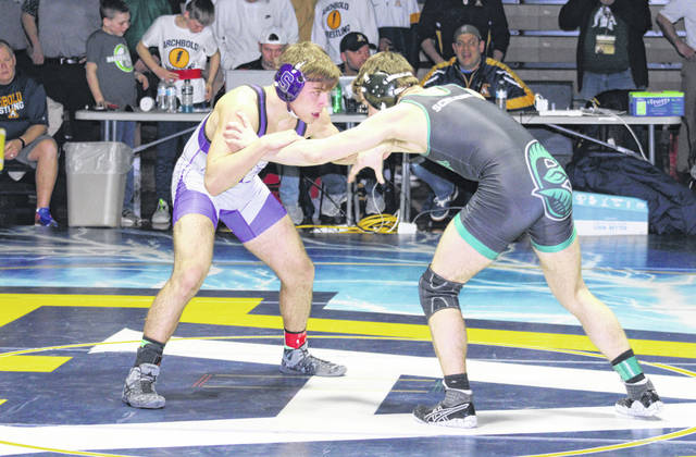 Tyler Gowing of Swanton, left, locks up with Lucas Schlegal of Tinora in the 152-pound final. However, he would fall 10-0 to Schlegal for a runner-up finish but still advanced to the district.