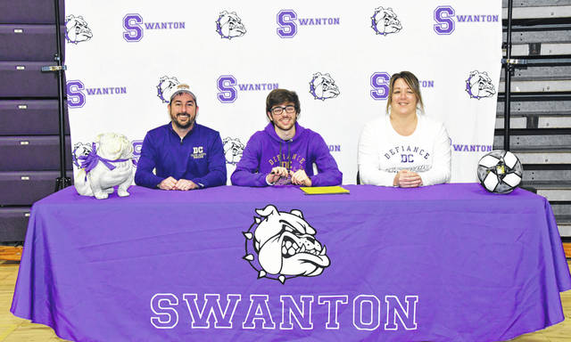 Cole Mortemore of Swanton recently signed a letter of intent to further his education and soccer career at Defiance College. From left: Robert Mortemore (father), Cole, Michelle Mortemore (mother).