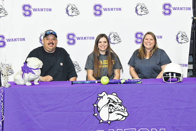 Swanton's Kylie Ulch recently signed a letter of intent to continue her softball and education career at Siena Heights University in Adrian, Michigan. From left: Charles Ulch (father), Kylie, and Tasha Caverly (mother).