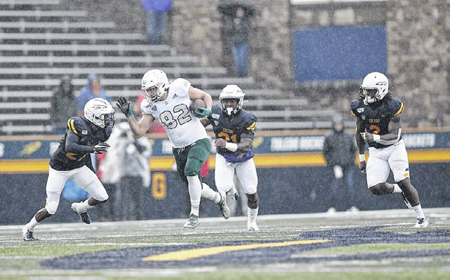 Swanton alum Gunnar Oakes with a catch and run for Eastern Michigan in a game last October against Toledo at the Glass Bowl. Oakes is set to enter his redshirt junior season in the fall.