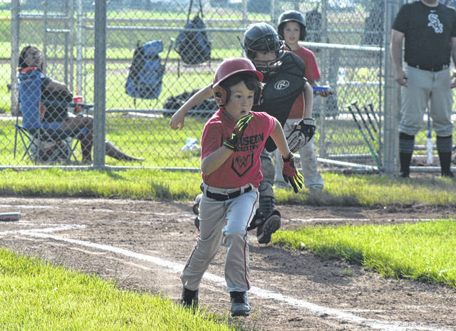 Brady McGuire of Wauseon runs out a base hit in a game at Biddle Park last summer. No little league baseball or softball games will take place at Biddle this season, as last week the Wauseon Recreation Association announced it is cancelling the 2020 summer recreation programs.