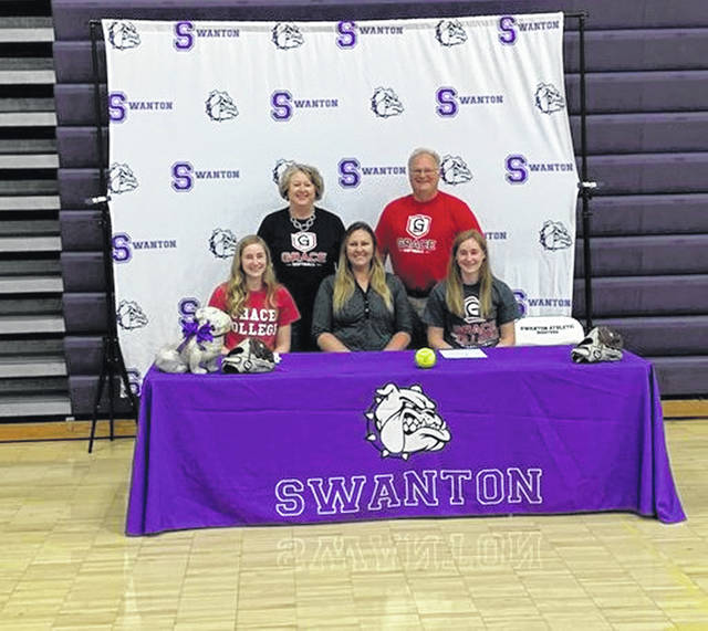 Twin sisters Alexis and Olivia Bergman, from Swanton, each signed letters of intent June 15 to continue their education and softball career at Grace College in Winona Lake, Ind. Front row, from left, are Olivia Bergman, Grace College head softball coach Sara Harmon and Alexis Bergman. In the back row are parents Kelly Bergman and Chris Bergman.