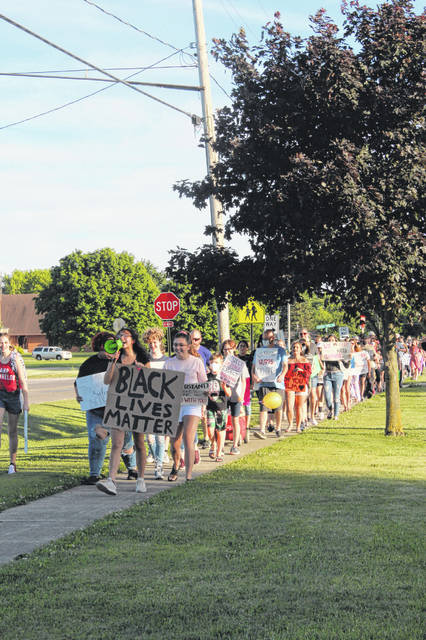 The Youth for Black Lives Matter march heads down the sidewalk on Taylor Street in Delta on June 8.