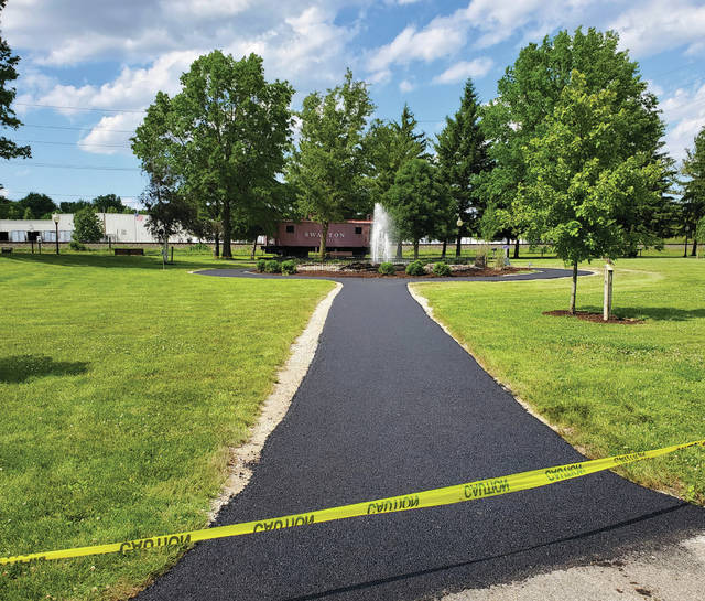 The Swanton Rotary Club had a new path completed Friday at Pilliod Park. The path goes from the main walkway to the fountain, and travels around it, on the way to another section of walkway.