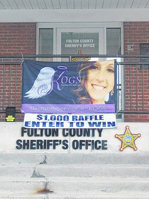 Banners like this one at the Fulton County Sheriff's Office are part of an online KOGS fundraiser.