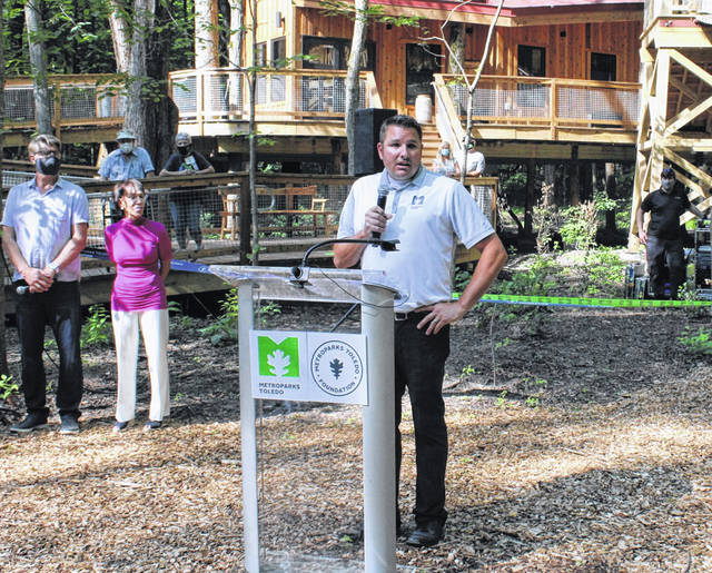 Metroparks Toledo Executive Director Dave Zenk introduces the completed Cannaley Treehouse Village for the first time during Wednesday's ribbon cutting ceremony in Swanton.