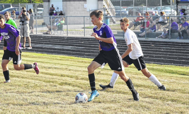 Swanton's Hayden Callicotte charges in from near the left sideline Tuesday in the NWOAL opener against Liberty Center. Callicotte recorded a hat trick as the Bulldogs took care of the Tigers, 6-1.