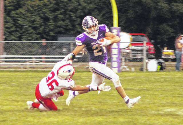 Swanton running back Ian Saunders fights off Owen Jardine of Patrick Henry during Saturday's game. Saunders accumulated over 100 yards rushing.