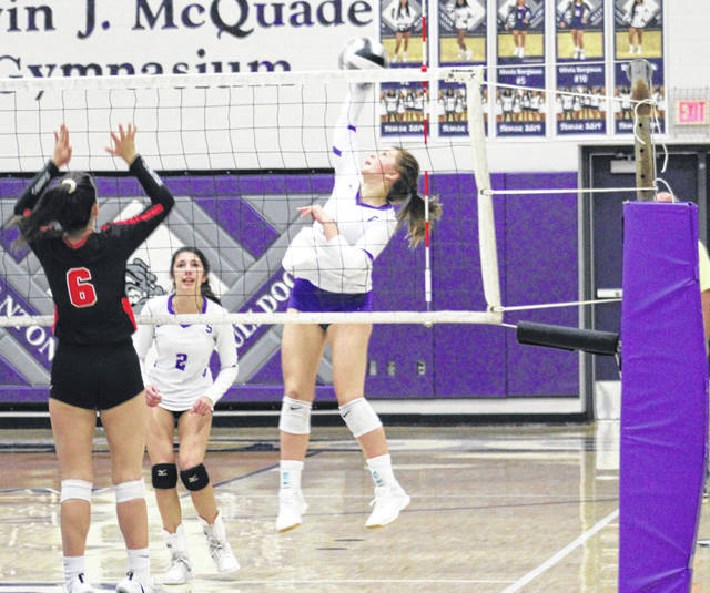 Sofie Taylor of Swanton blasts one from the left side during a match with Cardinal Stritch last season. She returns for the Bulldogs this season after being named honorable mention All-NWOAL and in District 7 a year ago.
