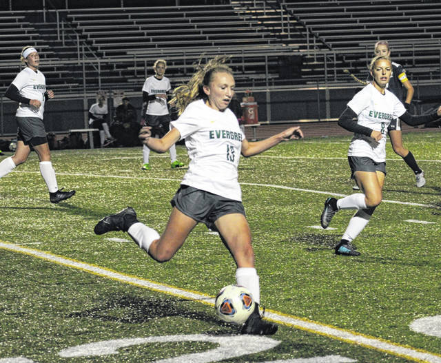 Evergreen's Sydney Woodring kicks the ball upfield in a district semifinal matchup with Archbold last season. Woodring is back for her junior season.