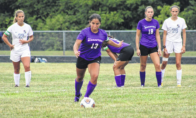 Aricka Lutz of Swanton readies to fire on her penalty kick opportunity late in Tuesday's game against Archbold. She would convert the chance and the Bulldogs held on for the win, 2-1.