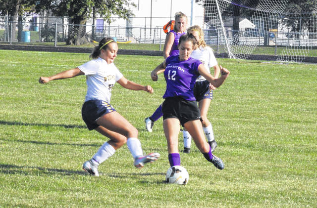 Riley Bellner of Swanton boots the ball upfield during Monday's game against Woodmore. Playing without their usual goalie, the Bulldogs fell hard to the Wildcats 7-1.