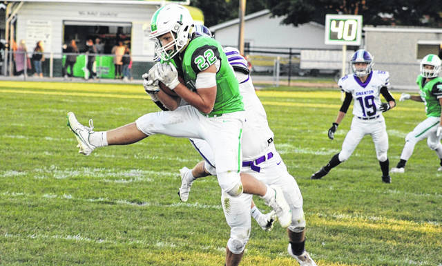 Delta's Shawn Cook jumps up to secure a grab during Friday night's game versus Swanton. The Panthers shut out the Bulldogs 44-0 to win back the Iron Kettle.