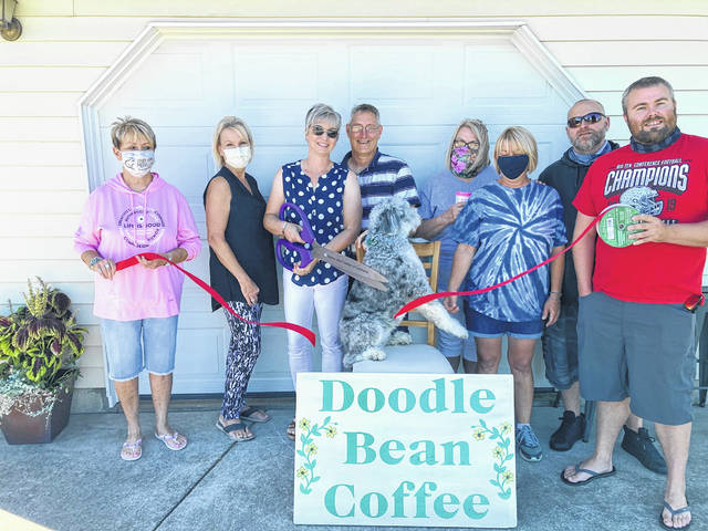 Doodle Bean Coffee in Swanton recently celebrated its grand opening with a ribbon-cutting ceremony. Owners Mary Jo and Matthew Boyd and their aussiedoodle, Selah, have created a fun dog-themed brand that will appeal to coffee and dog lovers alike. They roast their own beans, and currently offer six different varieties of both whole bean and ground coffee from five different origins from all over the world. Doodle Bean Coffee is a home-based business located at 13115 Angola Road, and will offer local pick-up and delivery as well as shipping to any location. They will also be active at local events, including farmer's markets, festivals, and more. Call 888-204-0464 or order online at www.doodlebeancoffee.com. Visit them on Facebook at Doodle Bean Coffee.