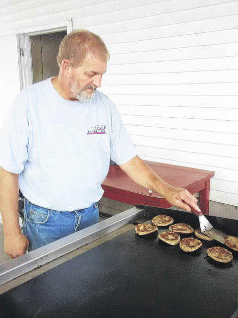 Phil Kohler of Lyons has grill duty for the Pork Producers booth at the Jr. Fair.