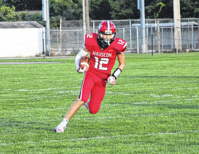 Wauseon wide receiver Jonas Tester with a catch and run in the first half of Friday's game against Evergreen. The Indians blanked the Vikings 48-0 to improve to 3-0 on the season.