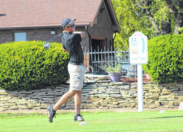 Aaron Miller of Evergreen on the tee at the 12th hole. He paced the Vikings with a 42.