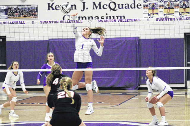 Swanton's Avril Roberts shoots one over the middle of the net Saturday morning in a match versus Gibsonburg. The Bulldogs managed a sweep of the Golden Bears 25-14, 25-23, 25-16.
