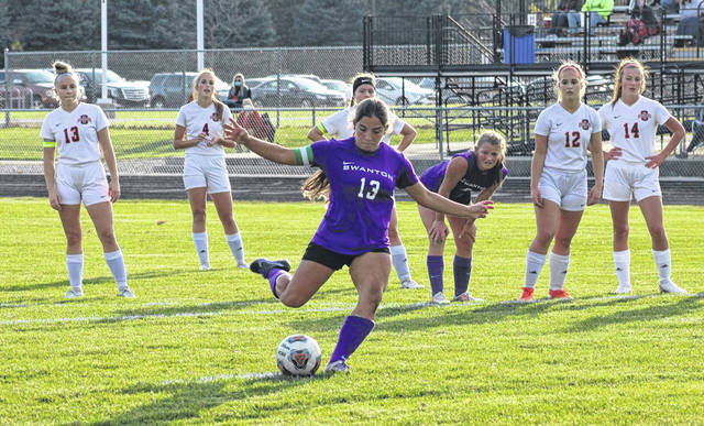 Aricka Lutz converts a penalty kick for Swanton to get the Bulldogs on the board first in their sectional semifinal matchup with Otsego on Wednesday. She would end up with four of the five Swanton goals in their 5-0 shutout of the Knights.