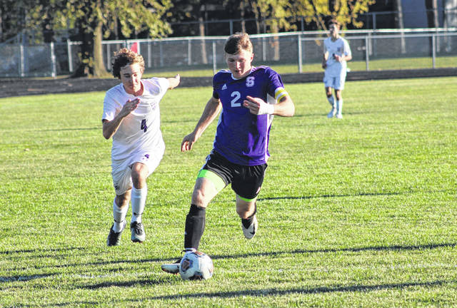 Swanton's Jon Byczynski charges upfield toward the Bryan goal in the first half of Thursday's NWOAL matchup. The Bulldogs recorded two goals in the final 10 minutes, pulling away for a 4-2 victory over the Golden Bears.