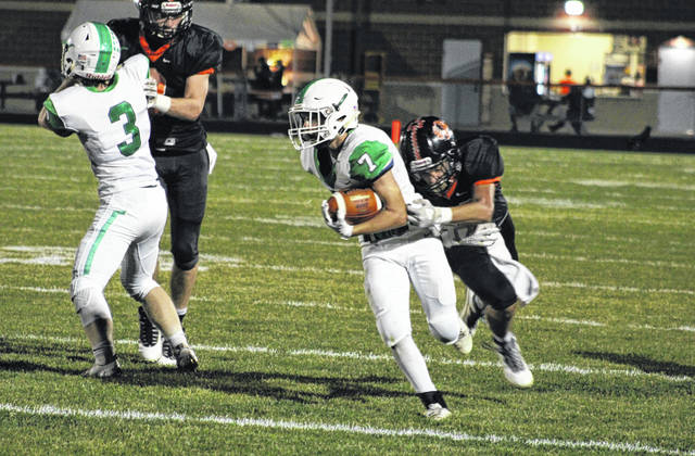 Delta running back Bryar Knapp slips a tackle as he picks 26 yards and a first down in the second quarter of Saturday's Division VI playoff game at Seneca East. He had a touchdown and a two-point conversion for the Panthers, who fell to the Tigers 32-28.