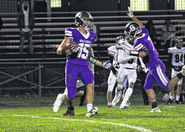 Swanton's Cole Mitchey looks for running room on a kickoff return Friday night versus Cardinal Stritch in a non-league game. Mitchey had a touchdown reception, recovered a fumble, and also made three extra points as the Bulldogs bested the Cardinals 27-13.