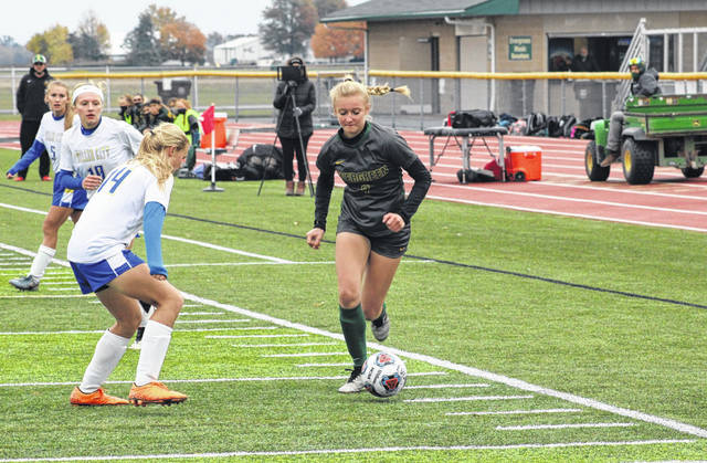 Evergreen's Kenzie Mitchey works the ball toward the goal during Tuesday's Division III girls soccer sectional final against Miller City. The Vikings would win by a 2-0 final.