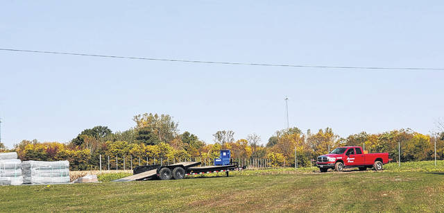 The beginnings of a fence are installed Friday at the site of the future solar array near Swanton High School.
