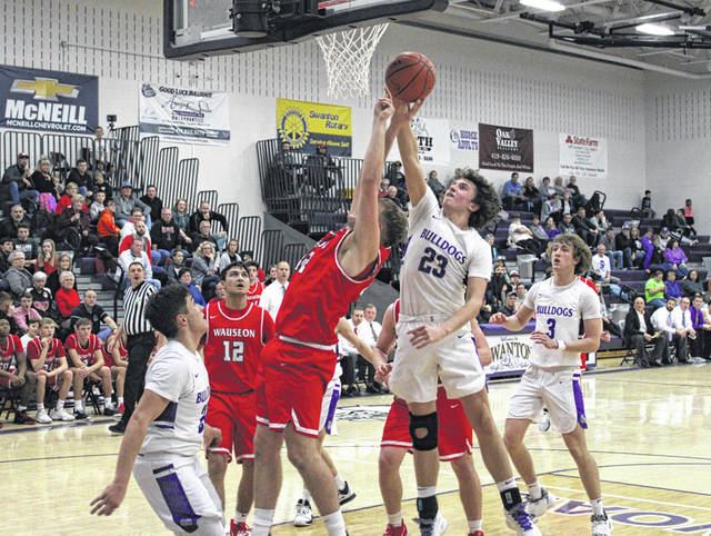Swanton's Andrew Thornton (23) stuffs Wauseon's Sean Brock during a NWOAL contest last season. Thornton returns for the Bulldogs this season after being named second team All-NWOAL, second team District 7 and honorable mention in the Northwest District in 2019-20.