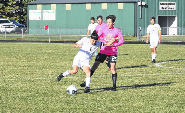 Quinn Wyse of Pettisville, left, controls a ball in a game at Delta. He was second team All-Ohio for the Blackbirds.