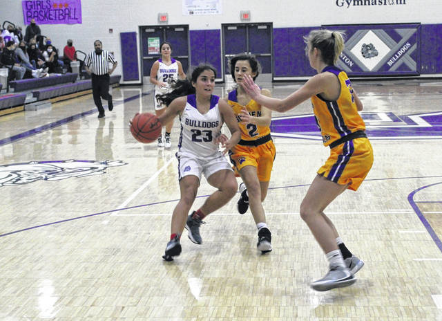 Averie Lutz of Swanton brings the ball up into the halfcourt during Friday's NWOAL opener with Bryan. She had 13 points for Swanton but the Bulldogs fell to the Golden Bears, 49-32.
