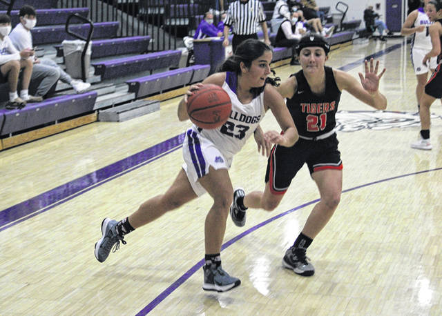 Averie Lutz of Swanton drives in from the wing as Cassidy Chapa of Liberty Center defends during the final of the Bob Fisher Holiday Classic on Tuesday, Dec. 29 in Swanton. After beating Northwood Monday, the Bulldogs fell to the Tigers 50-37 to serve as tournament runner-up.