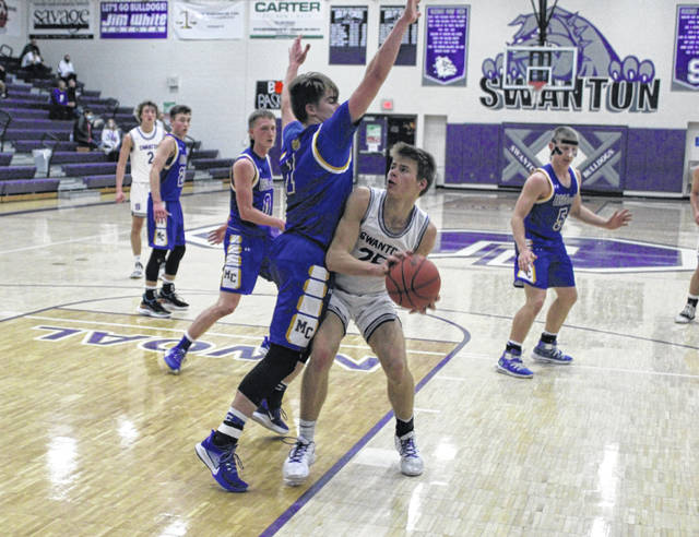 Cole Mitchey of Swanton looks for a basket inside in the semifinal of the Bob Fisher Holiday Classic versus Miller City held Monday, Dec. 28 in Swanton. Mitchey would make good on the shot for the Bulldogs, but they lost the game 60-39.