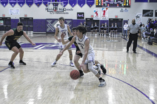 Josh Vance of Swanton drives in from the wing during Tuesday's non-league matchup with Clay. He tallied 14 points to help propel the Bulldogs to a 48-44 win over the Eagles.