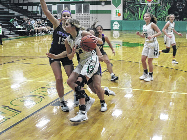 Braelyn Wymer of Delta drives inside looking to score during Thursday's game versus Swanton. The Panthers pulled away from the Bulldogs in the second half for a 49-33 win.