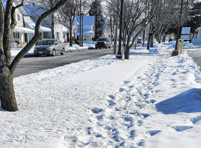 A stretch of S. Main Street in Swanton remained uncleared several days after it snowed. Fulton County communities are asking residents to heed snow clearing rules.