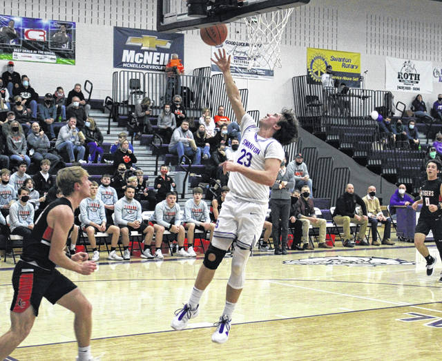 Swanton's Andrew Thornton lays one in during Friday's NWOAL battle with Liberty Center. The Bulldogs fell to the Tigers 48-41.