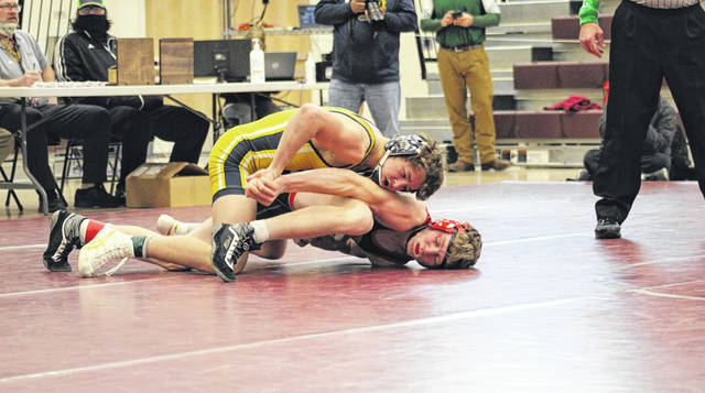 Archbold freshman Brodie Dominique holds down Mohawk's Owen England in the 138-pound district semifinal last weekend at the Rossford District. Dominique hopes to garner a first state placement for the Blue Streaks who compete at the Division III State Tournament at Marion Harding this Saturday and Sunday.
