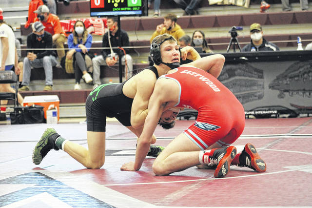 Delta's Zack Mattin holds down the head of Eastwood's Gavin Owens in the 132-pound district championship on Sunday. Mattin defeated Owens 7-2 to secure his third consecutive district title.