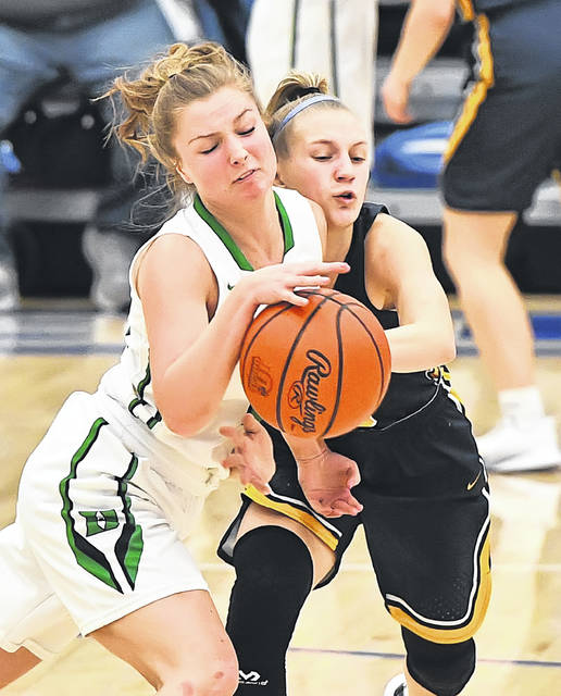 Ottawa-Glandorf's Lily Haselman, right, collides into Delta's Brooklyn Wymer during Wednesday's Division III regional semifinal game at the Defiance High School.
