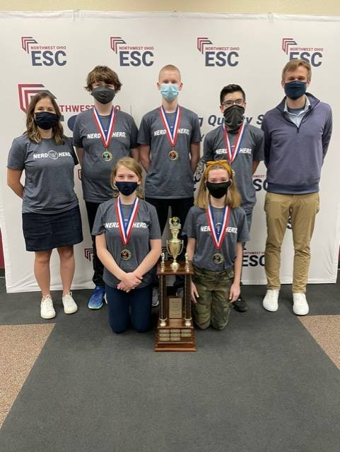 The winning Pettisville Junior High School varsity team includes - back, from left - Coach Rebecca Dorosz, Ryan Clark, Caden Bishop, Mitchell Velazquez, Coach Andy Switzer - front, from left - Emily VanDenBerghe, and Kendall Sears.