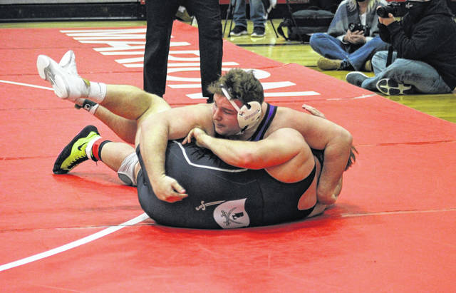 Swanton's Brodie Stevens, top, gains the upperhand on his opponent Cadman Roose of Benjamin Logan in the 285-pound third place match Sunday afternoon at the Division III state tournament at Marion Harding. Stevens won 10-3 to close out his career with a third place finish.