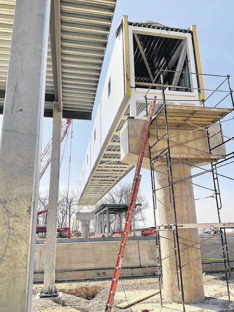 A pedestrian bridge for employees will travel over the Turnpike toll plaza.