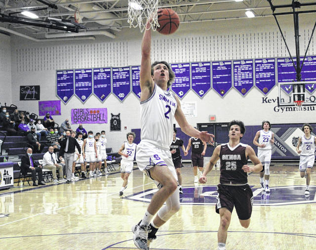 Josh Vance of Swanton lays one in after stealing the ball in the first half of Wednesday's Division III sectional semifinal against Genoa. The Bulldogs defeated the Comets 52-36 but couldn't get by Ottawa Hills on Friday in the sectional final, ending their season.