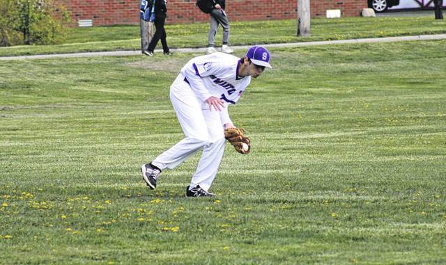 Swanton's Lucas Bloom fields a Liberty Center base hit in left field Thursday during a NWOAL matchup. The Bulldogs fell to the Tigers by a final of 10-7.